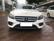 Bán Mercedes E300 AMG màu trắng, xe sản xuất 2016, đăng ký tháng 12/2016, tên cty hóa đơn cao giá 2 tỷ 360 tr tại Hà Nội