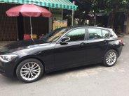Bán em BMW 116i đời 2013 màu đen số tự động 8 cấp giá 685 triệu tại Tp.HCM