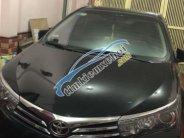 Cần bán lại xe Toyota Corolla altis 1.8l AT đời 2014, màu đen   giá 649 triệu tại Hà Nội