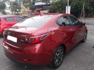 Bán Mazda 2 2016, màu đỏ, đúng chất, giá thương lượng, hỗ trợ trả góp giá 488 triệu tại Tp.HCM