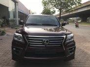 Bán Lexus LX570 màu đỏ mận, nội thất nâu, xe sản xuất và đăng ký 2014 một chủ đi từ đầu giá 4 tỷ 850 tr tại Hà Nội
