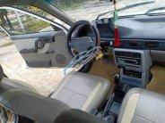 Cần bán gấp Mazda 323 MT đời 1995, màu trắng, nhập khẩu nguyên chiếc  giá 33 triệu tại Thanh Hóa