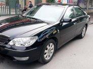 Bán xe Toyota Camry 2.4 G 2004, màu đen chính chủ giá 345 triệu tại Hà Nội