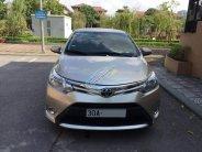 Gia đình cần bán Toyota Vios sản xuất 2014, số sàn, màu vàng cát, chính chủ giá 395 triệu tại Hà Nội