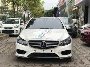 Cần bán xe Mercedes E400 AMG năm sản xuất 2016, màu trắng giá 1 tỷ 600 tr tại Hà Nội