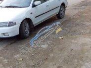 Bán Mazda 323 năm sản xuất 2000, màu trắng giá 85 triệu tại Thanh Hóa