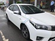 Bán ô tô Toyota Corolla Altis 1.8G AT năm sản xuất 2015, màu trắng   giá 670 triệu tại Kiên Giang