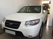 Cần bán xe Hyundai Santafe 2009 số sàn màu trắng ngọc trai bản full option 2 cầu giá 393 triệu tại Tp.HCM