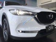 Cần bán lại xe Mazda CX 5 sản xuất năm 2018, màu trắng giá 1 tỷ 3 tr tại Tp.HCM