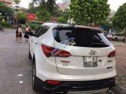 Bán Hyundai Santa Fe sản xuất năm 2016, màu trắng, giá chỉ 905 triệu giá 905 triệu tại Hà Nội