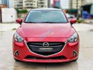 Cần bán lại xe Mazda 2 2015, màu đỏ, hỗ trợ trả góp 75% giá 490 triệu tại Hà Nội