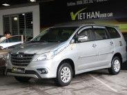 Cần bán xe Toyota Innova E 2.0MT đời 2014, màu bạc giá cạnh tranh giá 576 triệu tại Tp.HCM