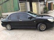 Cần bán xe Mitsubishi Lancer 1.8AT 2003 màu đen cọp giá 198 triệu tại Tp.HCM