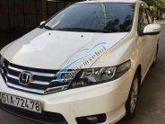 Cần bán gấp Honda City AT sản xuất năm 2014, màu trắng   giá 450 triệu tại Tp.HCM