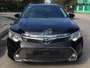 Cần bán Toyota Camry 2.0E sản xuất 2015, màu đen, số tự động giá 850 triệu tại Hải Phòng