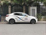 Cần bán xe Mazda 2 đời 2015, màu trắng còn mới, giá tốt giá 475 triệu tại Bình Dương