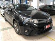 Cần bán Toyota Corolla altis G đời 2015, màu đen, giá 700tr giá 700 triệu tại Tp.HCM