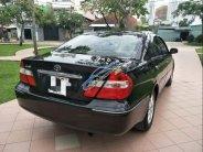 Bán gấp Toyota Camry AT 3.0V 2002, màu đen chính chủ, giá tốt giá 319 triệu tại Tp.HCM
