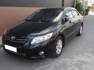 Cần tiền trả nợ bán gấp xe Altis đơi 2009 số sàn màu đen bóng giá 387 triệu tại Tp.HCM