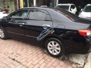Bán xe Toyota Corolla altis 1.8 AT sản xuất 2013, màu đen, chính chủ giá 586 triệu tại Hà Nội