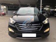 Bán Hyundai Santa Fe 4WD 2.4AT năm 2015, màu đen, số tự động  giá 908 triệu tại Tp.HCM