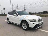 Bán xe BMW X1 năm 2011, màu trắng, nhập khẩu giá 620 triệu tại Hà Nội