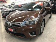 Bán gấp Toyota Corolla altis 1.8G MT sản xuất 2014, màu nâu số sàn, giá chỉ 620 triệu giá 620 triệu tại Tp.HCM