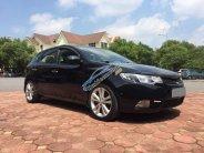 Cần bán xe Kia Cerato 1.6AT 2010, màu đen xe gia đình, giá 395tr giá 395 triệu tại Tp.HCM