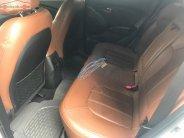Cần bán lại xe Hyundai Tucson 2.4 AT Limited năm sản xuất 2014, màu trắng, nhập khẩu  giá 701 triệu tại Tp.HCM