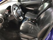 Bán Mazda 2 màu xanh tiger, số sàn 5 cửa, sản xuất 2012, lăn bánh 2014, biển Sài Gòn, đi đúng 32000km giá 346 triệu tại Tp.HCM