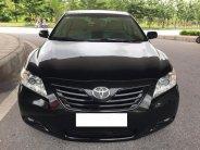 Cần bán xe Toyota Camry 2007 LE nhập Mỹ, màu đen giá 523 triệu tại Tp.HCM