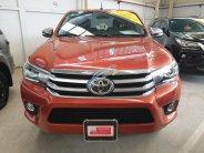(Hãng) bán xe Toyota Hilux 2.8G 4x4 AT sản xuất 2016, màu cam, nhập khẩu giá 790 triệu tại Tp.HCM