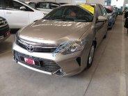 Cần bán Toyota Camry 2.0E sản xuất năm 2016, màu vàng số tự động, giá chỉ 950 triệu giá 950 triệu tại Tp.HCM
