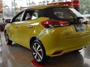 Bán Toyota Yaris 2018 1.5 màu vàng chanh, xe đang có sẵn giao ngay giá 650 triệu tại Tp.HCM