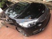Cần bán xe Kia Cerato đời 2015, màu đen, xe nhập, giá cạnh tranh giá 250 triệu tại Hà Nội
