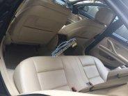 Bán xe BMW 5 Series 520i đời 2014, màu đen, xe nhập giá 1 tỷ 400 tr tại Tp.HCM