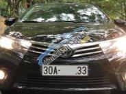Chính chủ bán Toyota Corolla altis 1.8 AT 2014, màu đen giá 650 triệu tại Hà Nội
