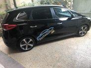 Gia đình bán Kia Rondo 2.0 GATH đời 2014, màu đen, full options giá 700 triệu tại Đà Nẵng