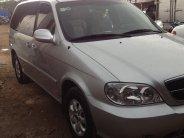 n xe Kia Canival 2009 số tự động màu bạc 7 chỗ giá 273 triệu tại Tp.HCM