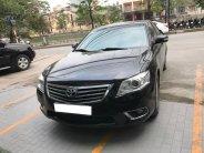Cần bán xe Camry 2.4G model 2011 số tự động màu đen vip giá 617 triệu tại Tp.HCM