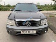 Cần bán Mazda Tribute năm sản xuất 2010, màu xám giá cạnh tranh giá 365 triệu tại Hà Nội