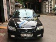 Bán xe Mazda 323 đời 2003 màu đen, đang sử dụng tốt giá 160 triệu tại Bắc Giang