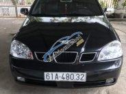 Cần bán Daewoo Lacetti 1.8MT đời 2004, màu đen, xe nhập xe gia đình giá 155 triệu tại Bình Dương