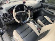 Cần bán lại xe Mazda 6 2.0 MT sản xuất 2003, màu đen giá 205 triệu tại Bắc Giang