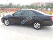 Bán xe Toyota Camry 2.4MT đời 2003, màu đen số sàn, giá chỉ 325 triệu giá 325 triệu tại Hà Nội