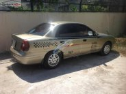 Bán xe Daewoo Nubira 1.6 đời 2000, màu vàng giá cạnh tranh giá 95 triệu tại Tiền Giang