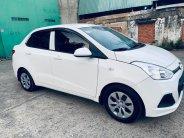 Cần bán xe Huyndai i10 sx 2016 số sàn màu trắng, bản sedan giá 325 triệu tại Tp.HCM