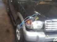 Cần bán gấp Mitsubishi Pajero đời 2002, màu đen xe gia đình, giá 110tr giá 110 triệu tại Gia Lai