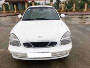 Cần bán gấp Daewoo Nubira năm 2002, màu trắng, số sàn, giá 145tr giá 145 triệu tại Tp.HCM