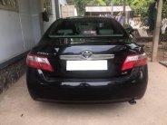 Cần bán xe Toyota Camry LE AT đời 2007, màu đen, còn mới giá 515 triệu tại Tp.HCM
